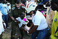 Flickr - Israel Defense Forces - Dr. Col. Kryce Transporting Injured Girl.jpg