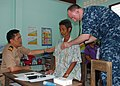 Flickr - Official U.S. Navy Imagery - US Navy physician and a Royal Thai Navy physician examine a patient's breathing.jpg