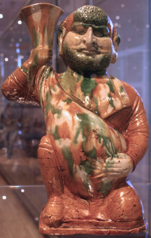 Wine in China - During the Tang dynasty (618–907), China started to import grape wine from Central Asia. Tang tricolor figurine of a Sogdian wine merchant holding a wineskin.