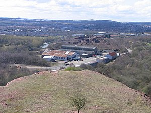 Broxburn - Former Broxburn shale oil works, taken from the top of the bing of spoil from the works. The surviving buildings of the works, now known as Albyn Industrial Estate, are in the middle of the picture. The villages of Broxburn and, to the right, Uphall are beyond and Livingston is visible on the skyline.