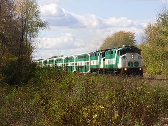 Lakeshore East line - GO Train approaches a level crossing at Galloway Road in Scarborough