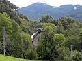 Gloggnitz - KG Aue - Semmeringbahn - Rumplertunnel und Bahnwärterhäuschen mit Railjet.jpg