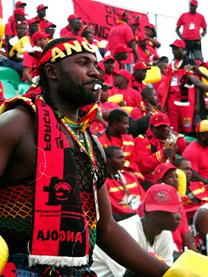 Angolan fans cheering during a match
