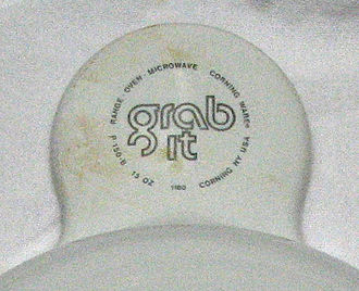 Grabit (cookware) - A closeup of the underside of an original grabit tab, showing its uses and place of origin.