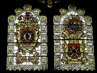 Medieval styled memorial window in Derry, featuring the Red Hand of Ulster as part of the arms of the 36th (Ulster) Division (l) Great War Memorial Windows, Guildhall, Derry.jpg