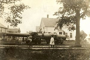 Fort Williams (Maine) - Children look on as a heavy gun is moved to Fort Williams via South Portland's trolley tracks.