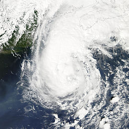 A view of Hurricane Gustav from Space on September 11, 2002. The storm is located over the open ocean, and is approaching landfall in Canada. New England is seen on the left side of the image.