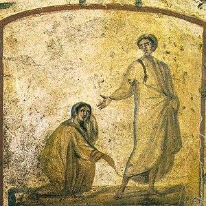English: Christ healing a bleeding woman Photo...