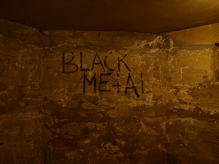 The basement of Helvete Helvete Oslo - black metal graffiti.jpg