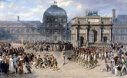 Military review in front of the Tuileries in 1810, by Hippolyte Bellange. The Arc de Triomphe du Carrousel, which can be seen on the right of this painting, used to be the entrance gate of the palace of the Tuileries and, with the Pavillon de Flore, is all that remains, above ground, of the palace at the site. Hippolyte Bellange - Un jour de revue sous l'Empire - 1810.jpg