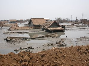 A home sunk by Sidoarjo mud flow. Taken by col...
