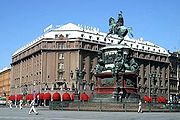 Hotel Astoria and a statue of Tsar Nicholas I of Russia in front, in Saint Petersburg