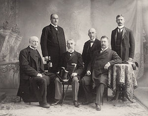 Seth Low - Seth Low (seated at right) with other members of the American delegation to the International Peace Conference, 1899