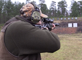 Hunter in standing unsupported firing position shooting range Sweden 01.png
