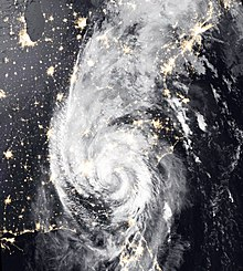 Nighttime satellite image of Michael and its circular rainbands over the Eastern US, with city lights visible