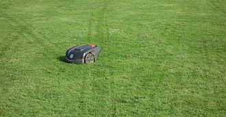 Robotic lawn mower - A robotic lawn mower with visible track marks in a lawn indicating the random way it cuts the grass.