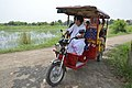ISKCON Disciple Guiding Toto Ridden Visitors - ISKCON Campus - Mayapur - Nadia 2017-08-15 1900.JPG