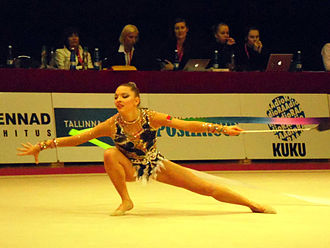 Melitina Staniouta - Staniouta at the 2013 Valentine World Cup with her signature skill; cossack turn starting on floor connecting to a penchee turn