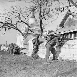 Indian Army during World War II - Troops of 19th Division open fire on a Japanese strong point in March 1945