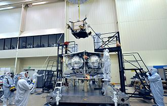 Juno Radiation Vault - Juno Radiation Vault (the box being lowered onto the partially constructed spacecraft) in the process of being installed on Juno, 2010