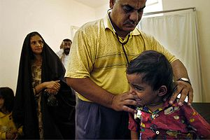Health in Iraq - Iraqi doctor treating a child