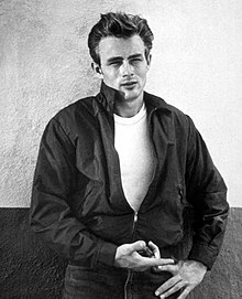 Black-and-white portrait of James Dean wearing a bomber jacket and Lee jeans