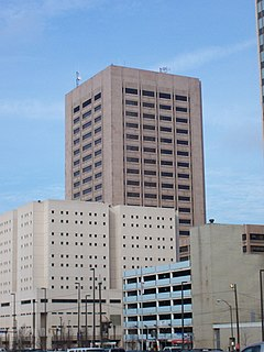 Street level view of group of buildings with tower, jail, parking garage