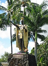 statue with palm trees