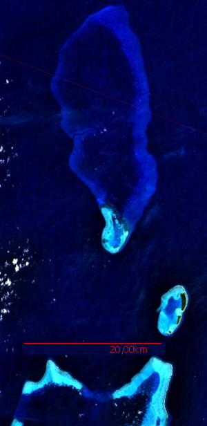 Kayangel - NASA satellite image: In the north, the large submerged Velasco Reef, in the center Ngaruangel Reef, lower right Kayangel Atoll, and below the northern Barrier Reef of Babelthuap, Ngerchelong Reef