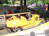 Yellow car in station at Kennywood Auto Race.