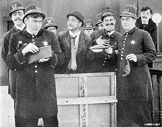 Keystone Cops - The Keystone Cops in The Stolen Purse (1913). Pictured left to right are Robert Z. Leonard, Mack Sennett, Bill Haber, Henry Lehrman, — McAlley, Chester Franklin, Ford Sterling, Fred Mace and Arthur Tavares.