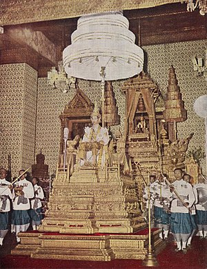 Coronation of the Thai monarch - King Bhumibol Adulyadej (Rama IX) on the Phuttan Kanchanasinghat throne, granting a general audience after the completion of his coronation on 5 May 1950.