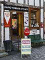 Kiosk med reklameskilt Oslo 1800.jpg
