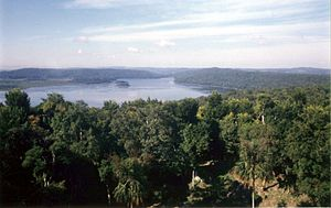 Spanish conquest of Petén - Lake Yaxha is surrounded by dense forest.