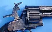 A close-up of the hammer on a LeMat Revolver, showing the pivoting striker that could be used to fire either the revolving chambers on the cylinder or the secondary smoothbore barrel.