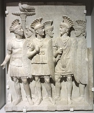 Praetorian Guard - Decor fragment of a Triumphal arch 51-52 AD: The Emperor's Imperial Guard, The Praetorians , featured in a relief with an eagle grasping a thunderbolt through its claws, in reference, to the Roman interpretatio graeca form of Jupiter.