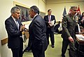 Leon E. Panetta meets with Australian Defense Minister Stephen Smith while at NATO headquarters in Brussels.jpg