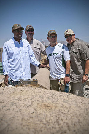 Eric Mangini - Mangini (far right) with Leslie Frazier, Bill Cowher and Ben Kotwicka in 2012.