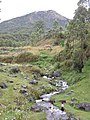 Life in the clouds. firewood collection and stream crossing with Mt Ramelau in the background, Hatu Builico valley, Ainaro, Timor-Leste.jpg