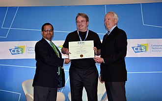 Linus Torvalds - Linus Torvalds receiving 2018 IEEE Masaru Ibuka Consumer Electronics Award from ICCE 2018 Conference Chair Saraju P. Mohanty and IEEE President James A. Jefferies at ICCE 2018 on 12 Jan 2018 in Las Vegas