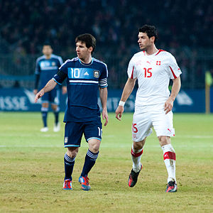 Blerim Džemaili - Džemaili marking Lionel Messi in a friendly against Argentina in 2012