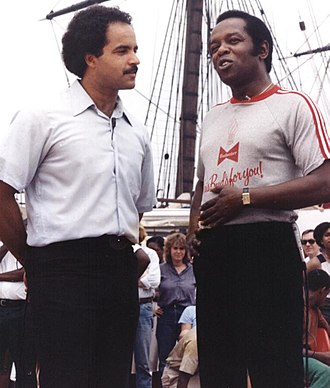 "Lou Rawls - Lou Rawls at Baltimore's Inner Harbor (1980) being interviewed by local news anchor Curt Anderson, promoting the ""Lou Rawls Parade of Stars Telethon"""