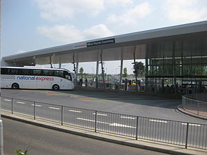 A National Express coach arrives at the Milton Keynes Coachway