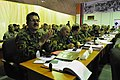Maj. Gen. Dawran, Afghan National Air Corps Wing Squadron Commander applauds the speeches conducted at the two day quarterly Corps Commander Conference and Security Shura (4522468029).jpg