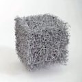 Malla aumentada de fibras de vidrio de un Filtro HEPA.png