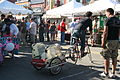 Man on bicycle with a dog in cycle trailer-19Sept2009.jpg
