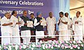 "Manmohan Singh being presented the 90th anniversary supplement, at the inauguration of the 90th Anniversary Celebrations of ""The Mathrubhumi"", in Kochi, Kerala. The Governor of Kerala, Shri Nikhil Kumar.jpg"