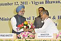 """Manmohan Singh being welcomed by the Union Minister for Road Transport and Highways, Dr. C.P. Joshi at the """"Conference on Public Private Partnership (PPP) in National Highways Challenges & Opportunities"""", in New Delhi.jpg"""