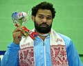 Mausam Khatri (India) winner of Gold Medal in 97kg Men's wrestling, during the presentation ceremony, at the 12th South Asian Games-2016, in Guwahati on February 08, 2016.jpg