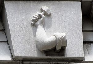 Mechanics' Bank and Trust Company Building - Arm-and-hammer symbol in the cornice above the building's top floor